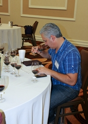 Maurice DiMarino, sommelier and wine buyer at San Diego's Island Prime, noses a wine.